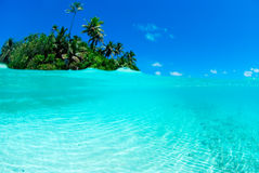 Split shot of tropical island. Over under shot Stock Images