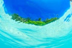 Split shot of tropical island. Over under shot Stock Photography