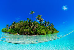 Split shot of tropical island. Over under shot Royalty Free Stock Images