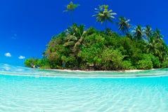 Split shot of tropical island. Over under shot Royalty Free Stock Image