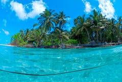 Split shot of tropical island. Over under shot Stock Image
