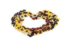 Split soy beans,mung beans,red kidney bean,black bean and Job's tears in heart shape Stock Image