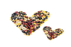 Split soy beans,mung beans,red kidney bean,black bean and Job's tears in heart shape Royalty Free Stock Photos