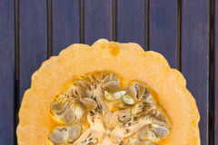 Split squash on wooden background Royalty Free Stock Images