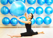 Split stretching exercises with fitness ball Stock Photo