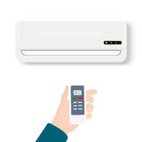 Split system air conditioner.Realistic conditioner with hand holding remote control. Vector illustration isolated on Stock Photo