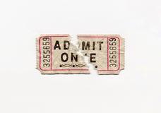 Split Ticket. An older trashed admit one ticket split in half Stock Photo