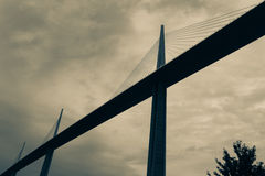 Split tone cable span bridge image from low point view Millau Br Royalty Free Stock Images