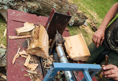 Split In Two. Wood splitting made easy Royalty Free Stock Images
