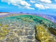 Split underwater view of Costa Rei shore Royalty Free Stock Photo