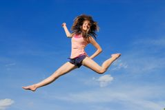 Split up in the air. Girl jump high up and do split up in the air Stock Photography