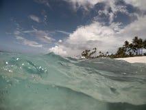 Split view half and half of choppy waves and sea underwater at M. Atautu, Lefaga, Upolu Island, Western Samoa, South Pacific royalty free stock photos