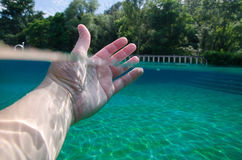 Split view of man hand underwater Royalty Free Stock Photos