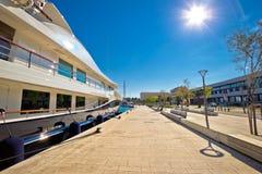 Split west coast walkway and luxury yachts dock Stock Photos
