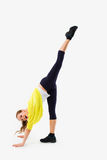 Split. Young woman doing stretching exercise. Royalty Free Stock Image