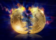 Splited gold bitcoin. On a wdark blue background Royalty Free Stock Image