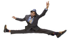 Splits. Athletic black man in a suit doing the splits Stock Photography