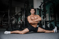Splits stretches man stretching legs in the gym handsome fitness Stock Photo