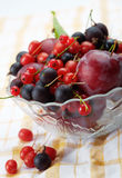 Splitted berries in a bowl. Mixed summer splitted berries in a cristal bowl on white Royalty Free Stock Photos
