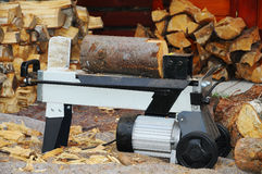 Splitter. For firewood with stacked logs Royalty Free Stock Photo