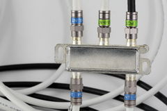 Splitter TV signal. With connectors and coax cables in backgroun Stock Images