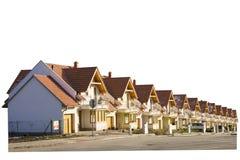Splitterny hus som i rad byggs Arkivbild