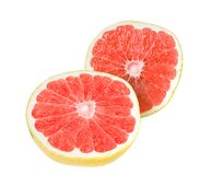 Splitting half, ripe, organic grapefruit isolated. Stock Photos
