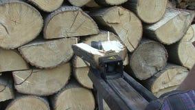 Splitting hydraulic log splitter stock video footage