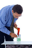 Splitting money. Businessman splitting money in two with ax Royalty Free Stock Photo