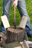 Splitting wood. Two flying pieces of wood on log royalty free stock photography