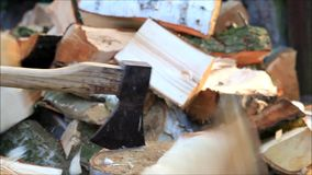 Splitting wood with a axe, manually, firewood stock footage