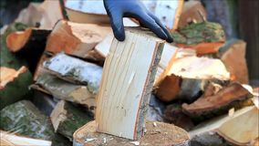 Splitting wood with a axe, manually, firewood stock video footage