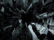 Splittrat eller demolerat exponeringsglas över svart bakgrund Royaltyfri Bild