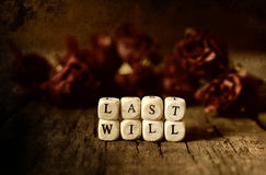 Splotchy retro effect on photo concept last will and testament. Small wooden blocks with letters on the old worn wooden table Royalty Free Stock Photography