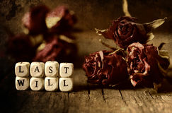 Splotchy retro effect on photo concept last will and testament. Small wooden blocks with letters on the old worn wooden table Stock Photography