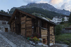 Swiss mountain town Spluegen with wooden house Royalty Free Stock Images