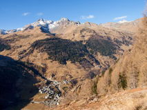 Spluga valley. Early winter of the valley pictures of mountains, the lake and the village of Montespluga Stock Photo