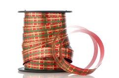 Spoel met decoratief rood lint Royalty-vrije Stock Afbeeldingen