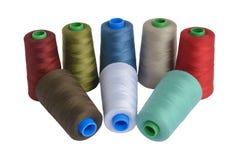 Spoelen van draad voor het naaien Stock Foto
