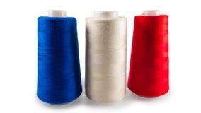 Spoelen van naaiende draden Stock Foto's