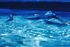 Spoeling 1 van het poolwater stock foto