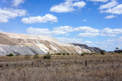 Spoil heaps from coal mine. The dumped top soil and unwanted layers from an open cut coal mine in Western Queensland Stock Image