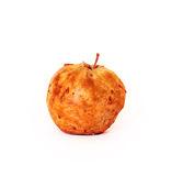 Spoiled apple on white background Stock Photography