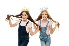 Spoiled children concept. Egocentric princess. Kids wear golden crowns symbol princess. Every girl dreaming become royalty free stock images