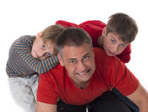 Spoiled children on their fathers back Royalty Free Stock Photos
