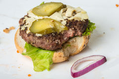 Spoiled tasteless burger with roasted not Cutlets, Royalty Free Stock Photography