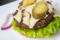 Spoiled tasteless burger with roasted not Cutlets, Stock Photography
