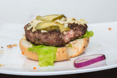 Spoiled tasteless burger with roasted not Cutlets, Royalty Free Stock Images