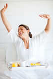 Spoiled woman having breakfast Stock Photography