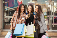 Spoiled women using their credit cards at a mall Royalty Free Stock Images